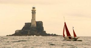 Jack O'Keeffe leads a race of Drascombes around the Fastnet Rock Photo: David McWhiter